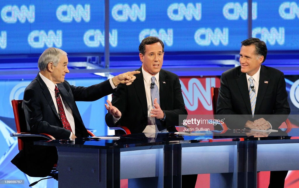 Republican presidential candidates (L-R) U.S. Rep. <a gi-track='captionPersonalityLinkClicked' href=/galleries/search?phrase=Ron+Paul&family=editorial&specificpeople=2300665 ng-click='$event.stopPropagation()'>Ron Paul</a> (R-TX), former U.S. Sen. <a gi-track='captionPersonalityLinkClicked' href=/galleries/search?phrase=Rick+Santorum&family=editorial&specificpeople=212911 ng-click='$event.stopPropagation()'>Rick Santorum</a> and former Massachusetts Gov. <a gi-track='captionPersonalityLinkClicked' href=/galleries/search?phrase=Mitt+Romney&family=editorial&specificpeople=207106 ng-click='$event.stopPropagation()'>Mitt Romney</a> participate in a debate sponsored by CNN and the Republican Party of Arizona at the Mesa Arts Center February 22, 2012 in Mesa, Arizona. The debate is the last one scheduled before voters head to the polls in Michigan and Arizona's primaries on February 28 and Super Tuesday on March 6.