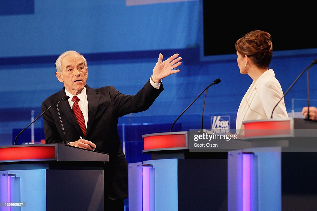 Republican presidential candidates U.S. Rep. <a gi-track='captionPersonalityLinkClicked' href=/galleries/search?phrase=Ron+Paul&family=editorial&specificpeople=2300665 ng-click='$event.stopPropagation()'>Ron Paul</a> (R-TX) (L), gets into a heated exchange with U.S. Rep. <a gi-track='captionPersonalityLinkClicked' href=/galleries/search?phrase=Michele+Bachmann&family=editorial&specificpeople=5578664 ng-click='$event.stopPropagation()'>Michele Bachmann</a> (R-MN), during the Fox News Channel debate at the Sioux City Convention Center on December 15, 2011 in Sioux City, Iowa. The GOP contenders are in the final stretch of campaigning in Iowa where the January 3rd caucus is the first test the candidates must face before becoming the Republican presidential nominee.