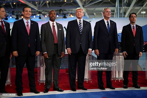 Republican presidential candidates US Sen Marco Rubio US Sen Ted Cruz Ben Carson Donald Trump Jeb Bush and Wisconsin Gov Scott Walker stand onstage...