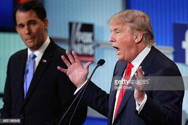 Republican presidential candidates Wisconsin Gov Scott Walker and Donald Trump participate in the first primetime presidential debate hosted by FOX...