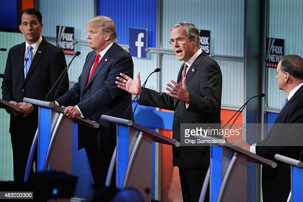 Republican presidential candidates Wisconsin Gov Scott Walker Donald Trump Jeb Bush and Mike Huckabee participate in the first primetime presidential...