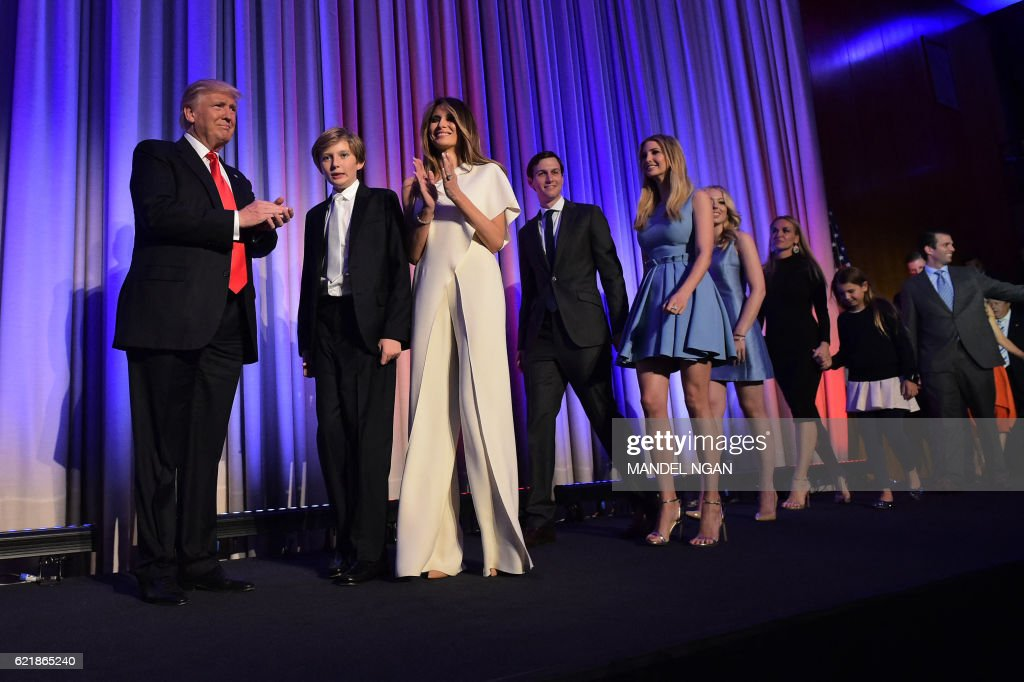 TOPSHOT - Republican presidential elect Donald Trump (L) arrives with his family to speak during election night at the New York Hilton Midtown in New York on November 9, 2016. / AFP PHOTO / Mandel NGAN