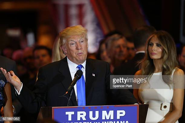 Republican presidential front runner Donald Trump stands near his wife Melania Trump as he speaks to supporters and the media at Trump Tower in...