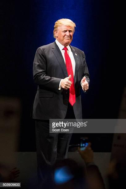 Republican presidential frontrunner Donald Trump gives thumbs up as he enters stage during his event at the Flynn Center for the Performing Arts on...