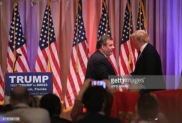 Republican Presidential frontrunner Donald Trump greets New Jersey Governor Chris Christie at his MarALago Club on Super Tuesday March 1 2016 in Palm...