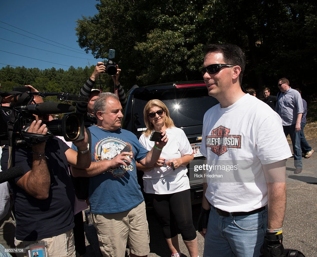 Republican Presidential Governor Scott Walker of Wisconsin starting a motorcycle ride campaign trip across New Hampshire on a Harley Davidson in...