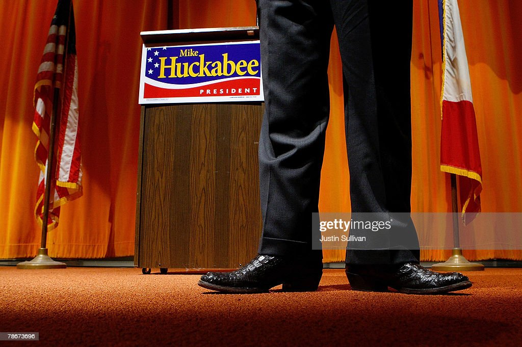 Republican presidential hopeful and former Arkansas governor Mike Huckabee wears alligator skin cowboy boots as he speaks at a 'Meet Mike Huckabee' event at the McCreary Community Center December 29, 2007 in Perry, Iowa. With less than a week to go before the Iowa caucus, Mike Huckabee has returned to Iowa to continue campaigning.