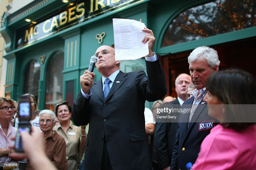 Republican presidential hopeful and former New York City Mayor Rudy Giuliani holds his proposed tax form while speaking to supporters at McCabe's Irish Pub & Grill January 23, 2008 in Naples, Florida. Giuliani continues his campaign strategy of concentrating heavily on Florida ahead of the state's January 29 primary.