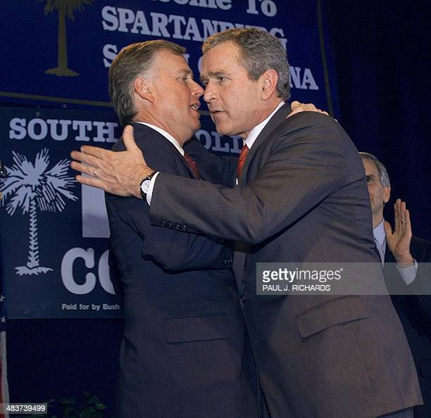 Republican presidential hopeful and Texas Governor George W Bush hugs former US VicePresident Dan Quayle during a rally at the Spartanburg Memorial...