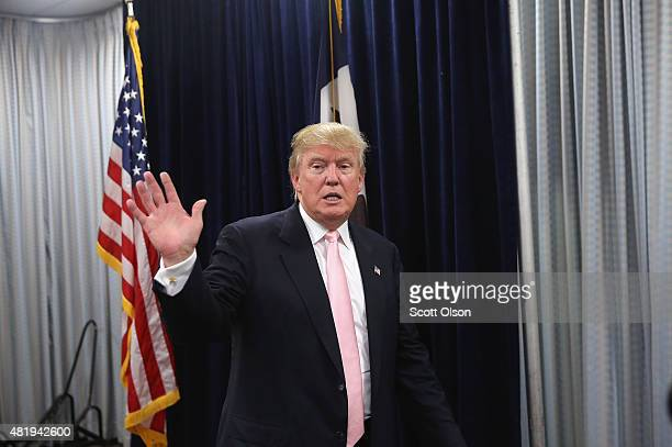 Republican presidential hopeful businessman Donald Trump leaves a press conference following a rally on July 25 2015 in Oskaloosa Iowa During his...