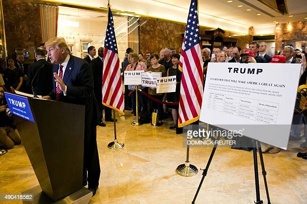Republican presidential hopeful Donald Trump announces his tax plan during a press conference at Trump Tower in New York on September 28 2015 AFP...