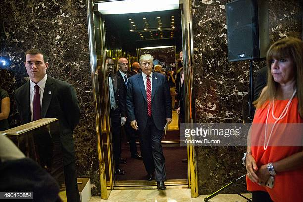 Republican presidential hopeful Donald Trump arrives to give a speech outlining his vision for tax reform at his skyscraper on Fifth Avenue on...
