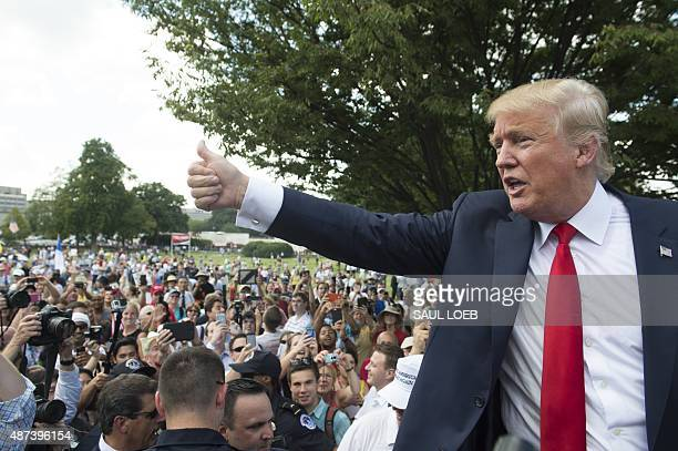 US Republican Presidential hopeful Donald Trump gives a thumbsup after speaking during a Tea Party rally against the international nuclear agreement...