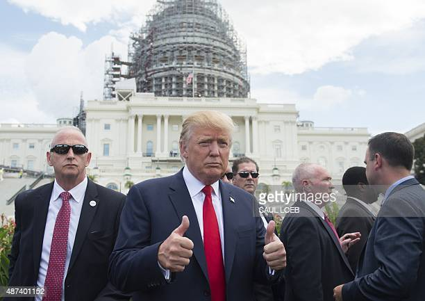 US Republican Presidential hopeful Donald Trump gives a thumbsup as he arrives for a Tea Party rally against the international nuclear agreement with...