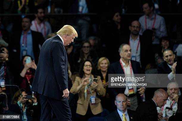 US Republican presidential hopeful Donald Trump leaves after addressing the 2016 American Israel Public Affairs Committee policy conference at the...