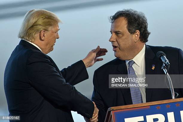 US Republican presidential hopeful Donald Trump shakes the hand of New Jersey Governor Chris Christie after an introduction during a rally March 14...