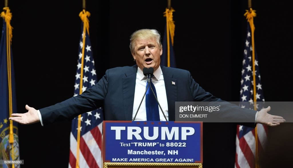 US Republican presidential hopeful Donald Trump speaks to the crowd during a rally February 8, 2016 in Manchester, NH. US presidential candidates, including billionaire Donald Trump and under-pressure Democrat Hillary Clinton, criss-crossed snowy New Hampshire in a final frantic bit to win over undecided voters before Tuesday's crucial primary. / AFP / Don EMMERT