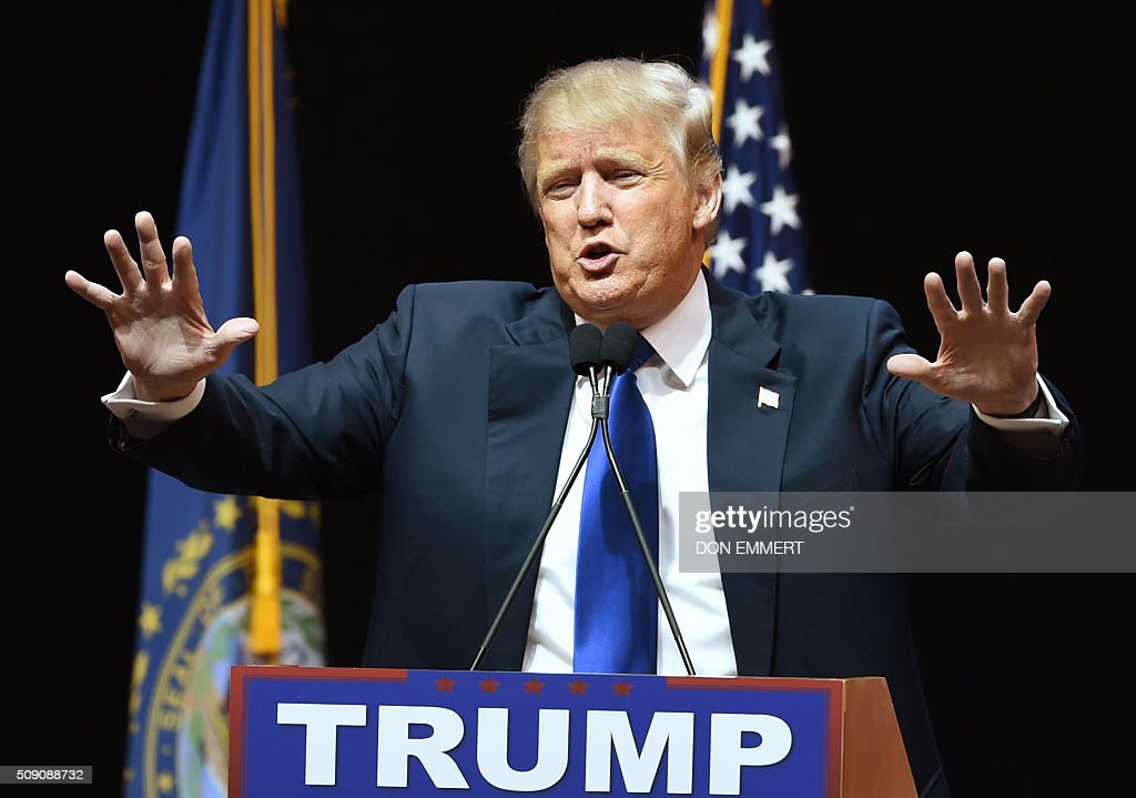 Republican presidential hopeful Donald Trump speaks to the crowd during a rally February 8, 2016 in Manchester, NH. US presidential candidates, including billionaire Donald Trump and under-pressure Democrat Hillary Clinton, criss-crossed snowy New Hampshire in a final frantic bit to win over undecided voters before Tuesday's crucial primary. / AFP / Don EMMERT