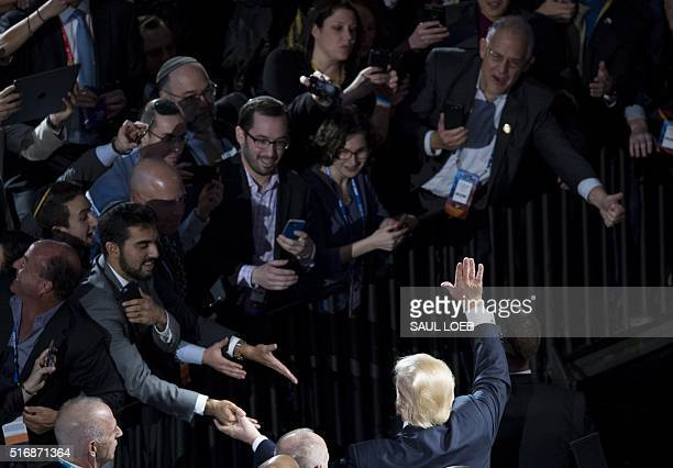 US Republican presidential hopeful Donald Trump waves addressing the American Israel Public Affairs Committee 2016 Policy Conference at the Verizon...