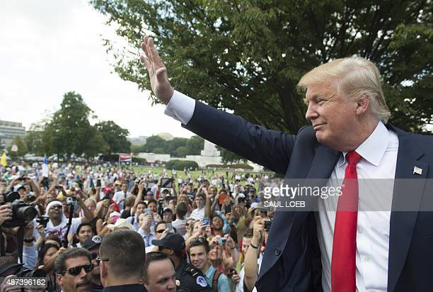 US Republican Presidential hopeful Donald Trump waves after speaking during a Tea Party rally against the international nuclear agreement with Iran...