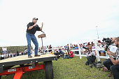 Republican presidential hopeful former Texas Governor Rick Perry speaks at a Roast and Ride event hosted by freshman Senator Joni Ernst on June 6...