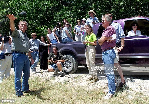 Republican Presidential hopeful George W Bush and his wife Laura Bush give a tour of their ranch to the media in Crawford Texas 21 July 2000 Bush...