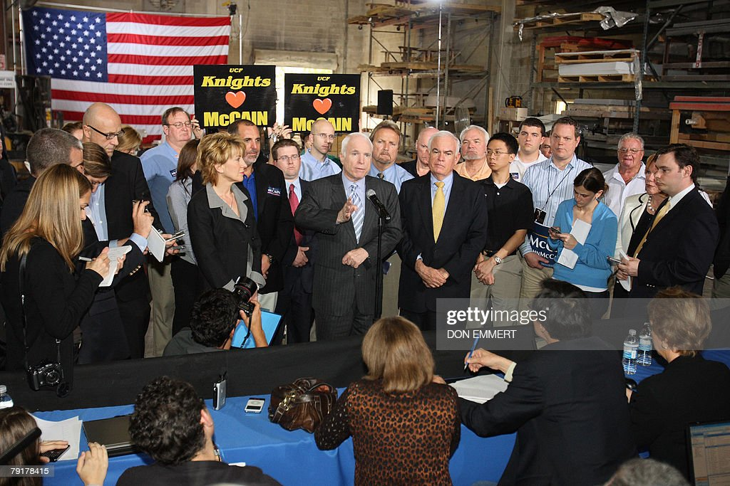 US Republican presidential hopeful John McCain answers reporters questions after an economic roundtable meeting at Baker Manufacturing Company 23 January 2008 during a campaign stop In Orlando, ahead of Florida's 29 January presidential primary. AFP PHOTO/Don EMMERT