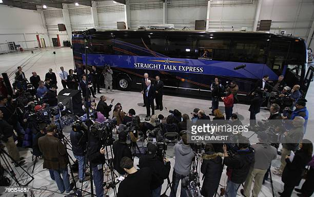 US Republican Presidential hopeful John McCain talks to reporters in front of his bus the Straight Talk Express February 6 2008 in Phoenix Arizona...