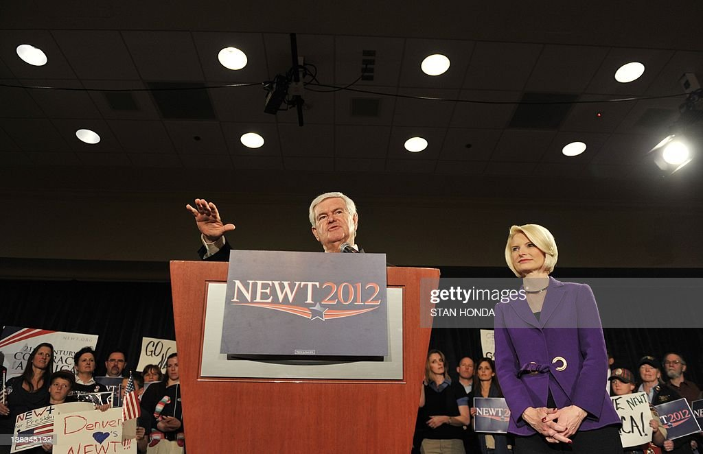 Republican presidential hopeful Newt Gingrich and his wife Callista Gingrich appear at a rally February 6, 2012 in Golden, Colorado, on the eve of the state caucus. Republican presidential hopeful Newt Gingrich looked to a 'Super Tuesday' vote bonanza in March to rescue his faltering campaign after a second consecutive thumping from rival Mitt Romney in Nevada. Colorado, Minnesota and Missouri vote on February 7th, before Arizona and Michigan on February 28, and then the state of Washington on March 3. AFP PHOTO/Stan HONDA