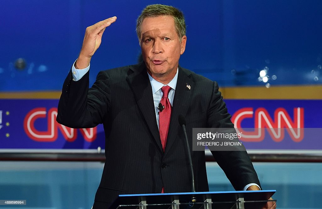 Republican presidential hopeful Ohio Gov John Kasich gestures while speaking during the Presidential debate at the Ronald Reagan Presidential Library...