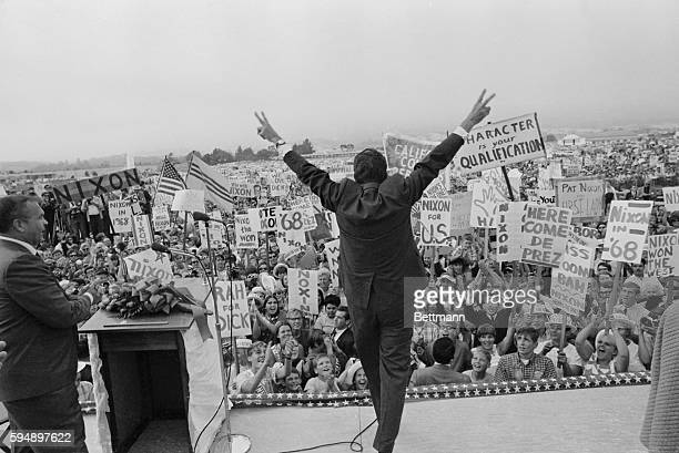 Republican Presidential hopeful Richard MNixon makes the 'V' for victory sign to an enormous crowd of enthusiastic supporters who greeted him on his...
