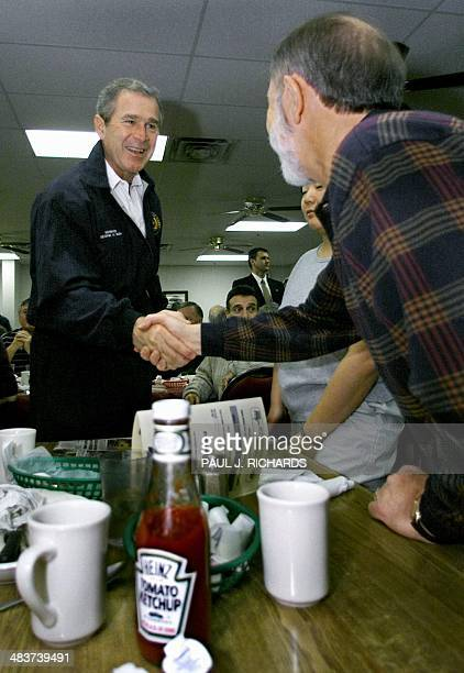 Republican presidential hopeful Texas Governor George W Bush greets diners early 19 February 2000 at Tommy's Country Ham House in Greenville South...