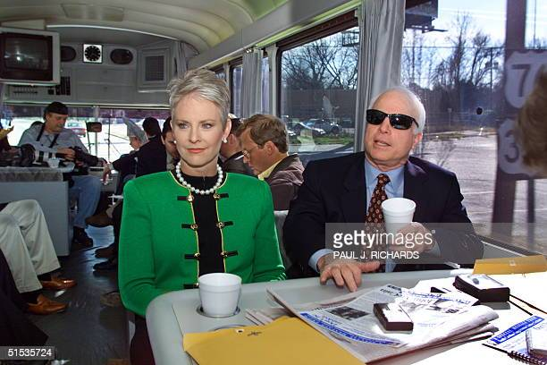 Republican presidential hopeful US Senator John McCain and his wife Cindy speak with reporters as they travel from Columbia to Sumter South Carolina...