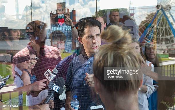 Republican presidential hopeful Wisconsin Governor Scott Walker greets guests gathered for a campaign event at Modern Woodman Park on July 17 2015 in...