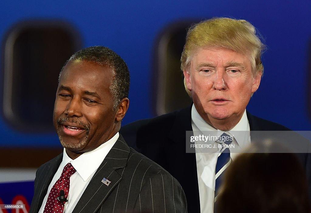 Republican presidential hopefuls Ben Carson and Donald Trump participate in the Republican Presidential Debate at the Ronald Reagan Presidential...