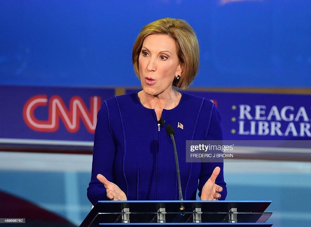 Republican presidential hopefuls Carly Fiorina speak during the Republican presidential debate at the Ronald Reagan Presidential Library in Simi...