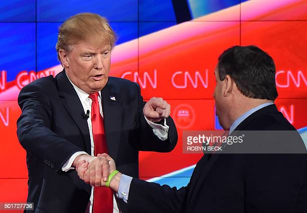 Republican presidential hopefuls Donald Trump and Chris Christie shake hands at the Republican Presidential Debate hosted by CNN at The Venetian Las...