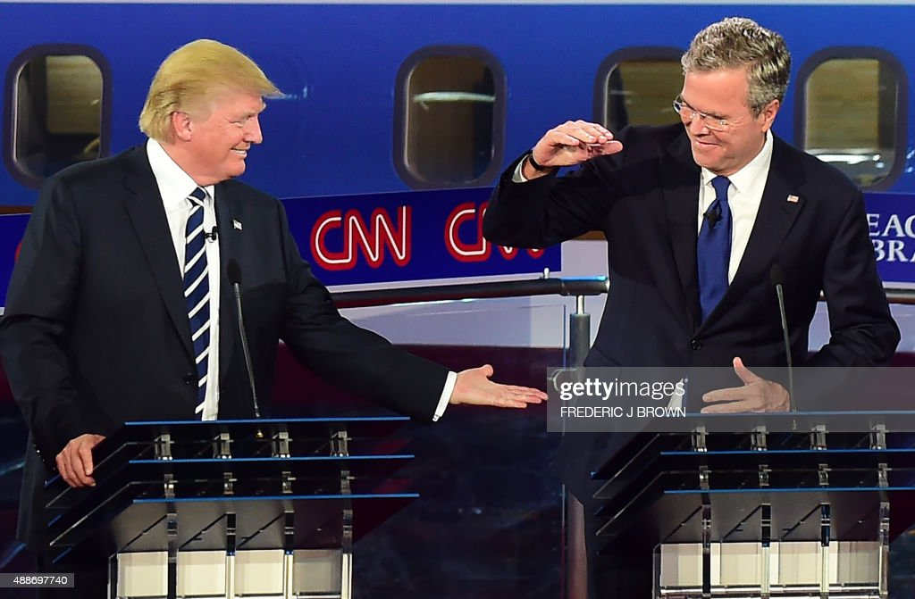 Republican presidential hopefuls Donald Trump and Jeb Bush high five during the Republican Presidential Debate at the Ronald Reagan Presidential...