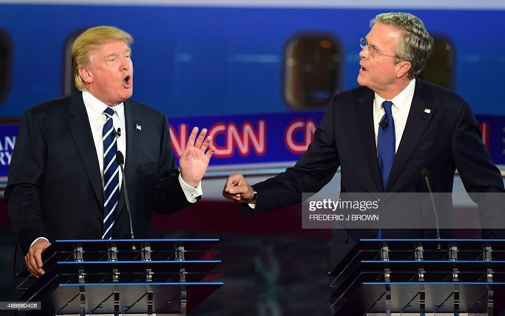 Republican presidential hopefuls Donald Trump and Jeb Bush speak during the Republican presidential debate at the Ronald Reagan Presidential Library...