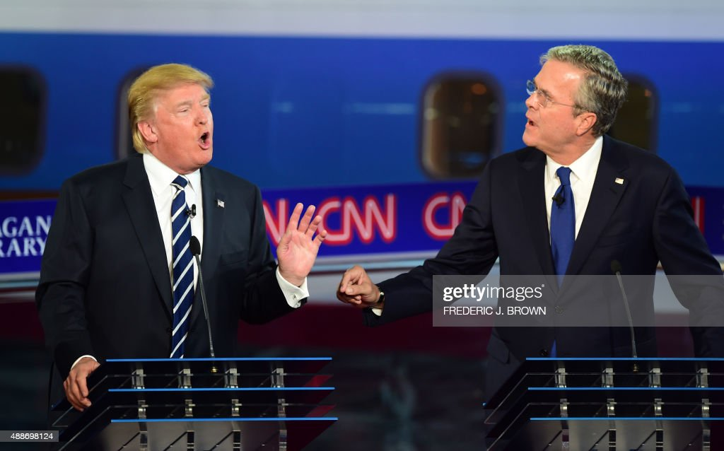 Republican presidential hopefuls Donald Trump and Jeb Bush speak during the Presidential debate at the Ronald Reagan Presidential Library in Simi...