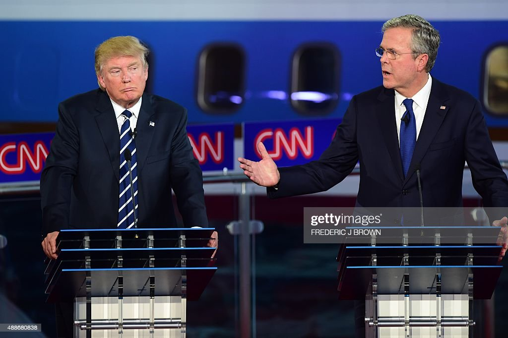 Republican presidential hopefuls Donald Trump looks on as Jeb Bush speaks during the Republican presidential debate at the Ronald Reagan Presidential...