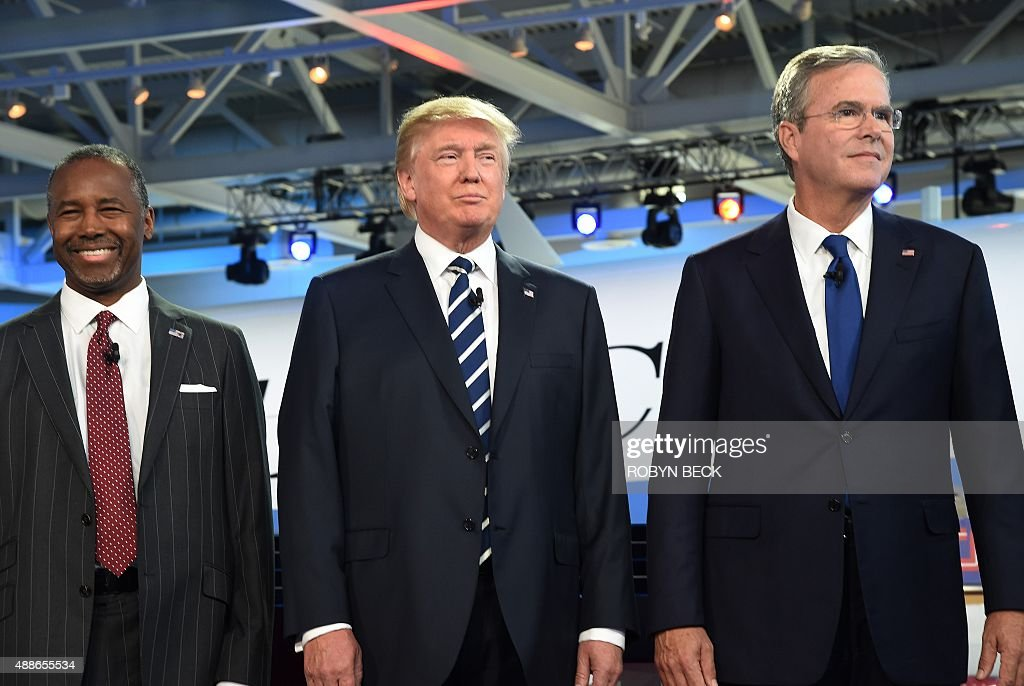 Republican presidential hopefuls retired neurosurgeon Ben Carson real estate magnate Donald Trump and former Florida Gov Jeb Bush arrive on stage for...