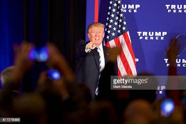 Republican Presidential nominee Donald J Trump acknowledges supporters after holding an event at the Eisenhower Hotel and Conference Center October...