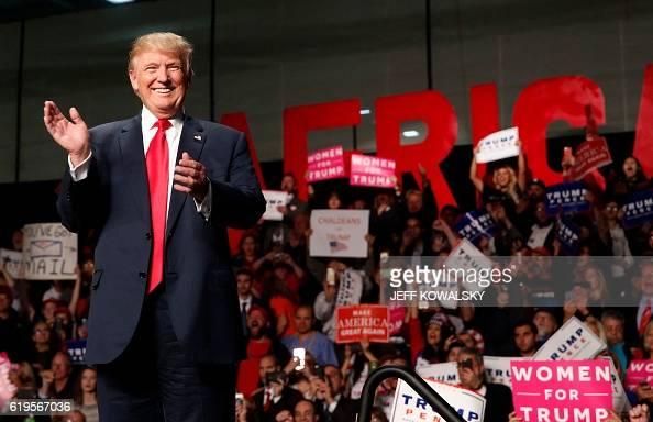US Republican Presidential nominee Donald Trump addresses supporters at Macomb Community College on October 31 2016 in Warren Michigan Donald Trump...
