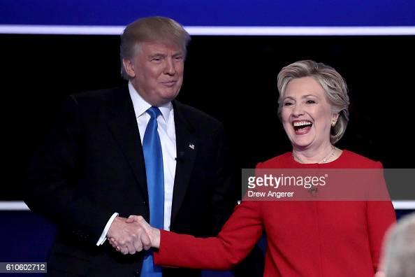 Republican presidential nominee Donald Trump and Democratic presidential nominee Hillary Clinton shake hands after the Presidential Debate at Hofstra...