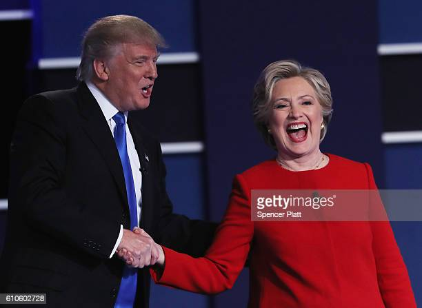 Republican presidential nominee Donald Trump and Democratic presidential nominee Hillary Clinton shake hands after the Presidential Debate at Hofstra...