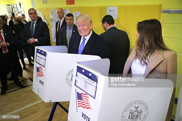 Republican presidential nominee Donald Trump and his wife Melania Trump cast their votes on Election Day at PS 59 November 8 2016 in New York City...