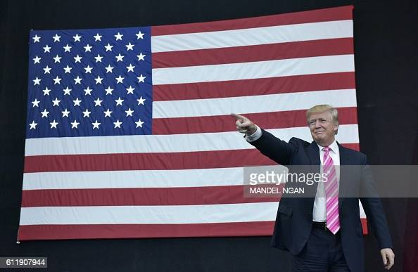 TOPSHOT Republican presidential nominee Donald Trump arrives for a rally at Spooky Nook Sports center in Manheim Pennsylvania on October 1 2016 / AFP...