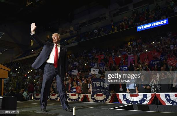 TOPSHOT Republican presidential nominee Donald Trump arrives on stage during a rally at Mohegan Sun Arena in WilkesBarre Pennsylvania on October 10...