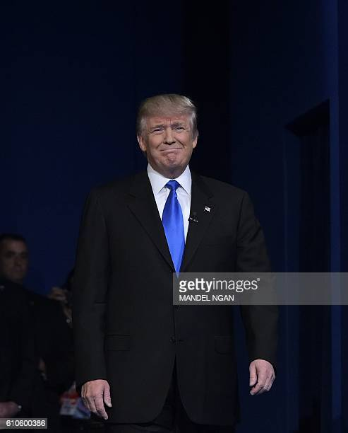 Republican presidential nominee Donald Trump arrives on stage for the first presidential debate at Hofstra University in Hempstead New York on...